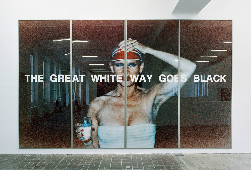 Katharina Sieverding, THE GREAT WHITE WAY GOES BLACK, IX, 1977. Color photograph, acrylic, and steel frames, 300 x 500 cm. Installation view of the exhibition: Katharina Sieverding – Close Up, KW Institute for Contemporary Art Berlin, 2005 © Katharina Sieverding, VG Bild-Kunst, Bonn 2021.