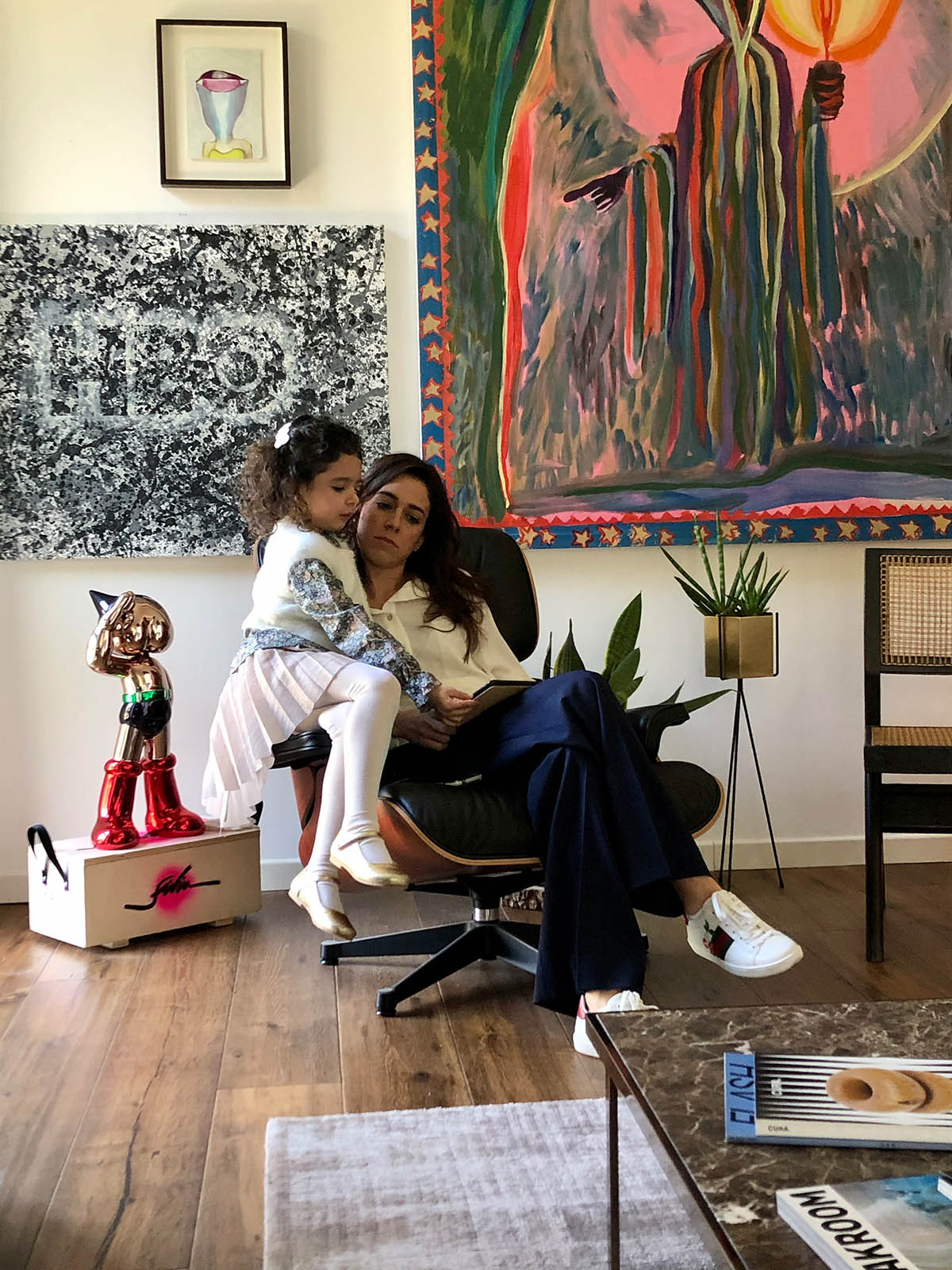 Irene & Sofia at home reading a magazine