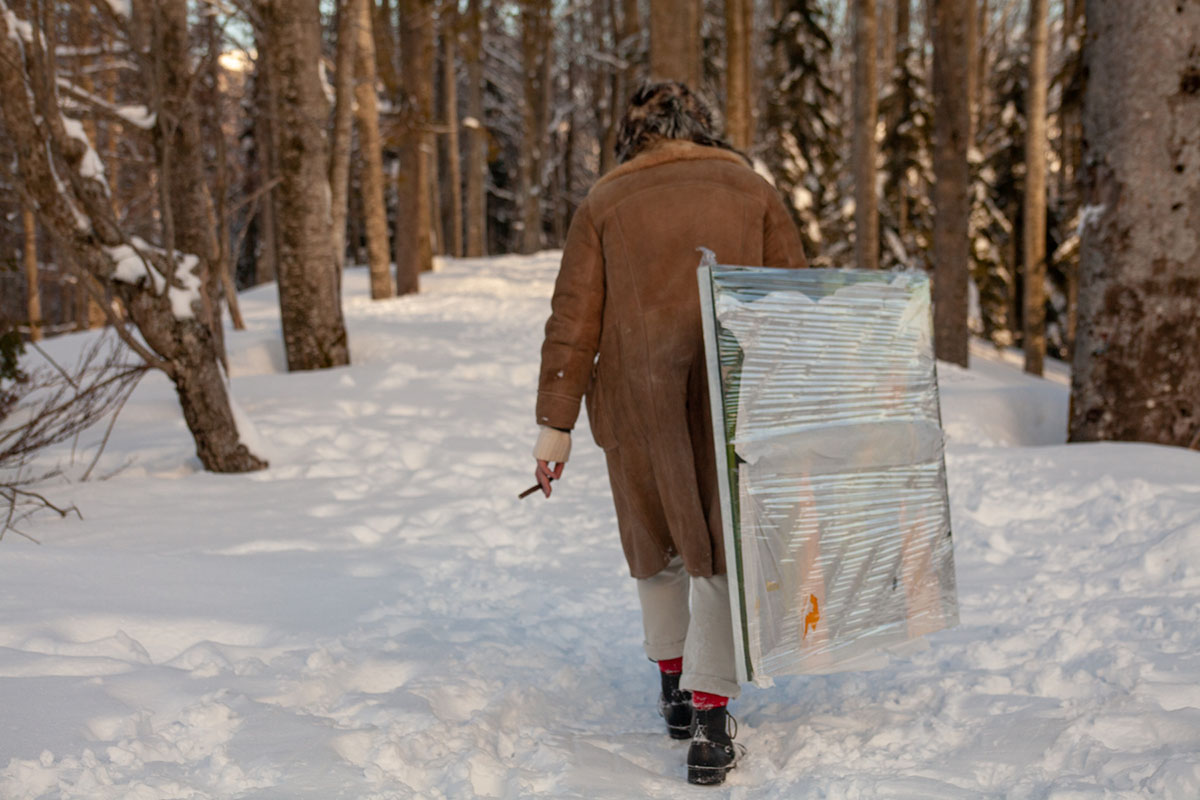 Luigi Presicce installing a piece by Francesco Lauretta into the woods in Abetone (Pistoia) during the second Polka