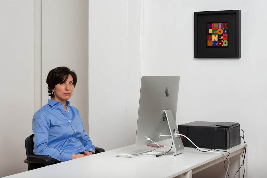 Tatiana Yasinek in the office with a work by Alighiero Boetti, photo by Mattia Mognetti